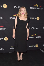 Elisabeth Moss chose a dotted ruffle-hem dress by Alexis for the HFPA and InStyle TIFF celebration.