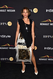 Carmen Ejogo completed her sparkly outfit with a paillette-embellished pencil skirt, also by Christopher Kane.