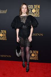 Kaitlyn Dever matched her LBD with sheer black tights.