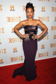 Anika Noni Rose was all about vampy glamour in a strapless purple Georges Chakra gown with a metallic bodice and a fishtail hem during the 'Night One' premiere of 'Roots.'