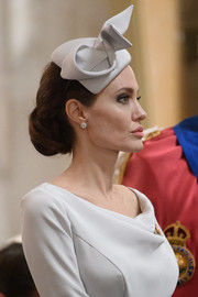 Angelina Jolie paired her classic 'do with a sculptural gray fascinator.