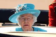 Queen Elizabeth II donned a bright blue Angela Kelly hat with flower detail for the Trooping the Colour.
