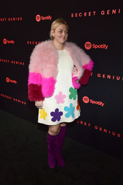 Elle King couldn't get enough of color! For her footwear, she chose a pair of purple knee-high boots.