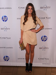 Samantha looked fabulous in a shimmering tunic dress with peep toe ankle booties.
