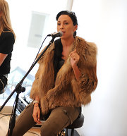 Danish singer Medina combined glam and rugged by teaming a fur coat with a pair of cargo pants.