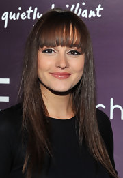 Leighton Meester went sleek and straight at the HTC Serves Up NYC product launch event. To try her look, use a flat iron to smooth hair section by section. To finish, spritz on a product like Fekkai Brilliant Glossing Sheer Shine mist.