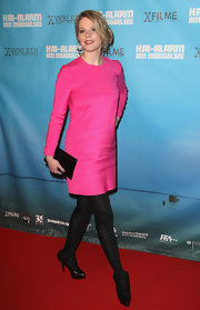 Anna-Maria Hirsch chose this hot pink, long-sleeved cocktail dress for her feminine and fun look at a premiere in Berlin.