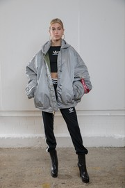 Hailey Baldwin struck a pose at the Streets of EQT fashion show wearing a pair of Adidas pants and a matching crop-top.