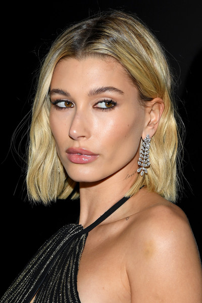 Hailey Bieber Diamond Chandelier Earrings [hair,face,eyebrow,hairstyle,blond,chin,lip,beauty,shoulder,nose,hailey bieber,saint laurent,part,paris,france,paris fashion week womenswear fall,saint laurent : photocall - paris fashion week womenswear fall,leslie bibb,actor,celebrity,blond,november 17,model,1974]