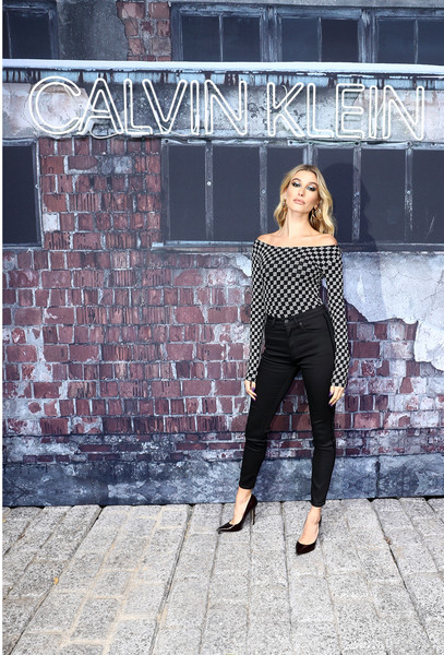 Hailey Bieber Skinny Jeans [calvin klein,hailey bieber,shoulder,clothing,black,street fashion,fashion,beauty,dress,joint,leg,black-and-white,a night of music,discovery and celebration,a night of music,event,discovery and celebration,berlin,germany]