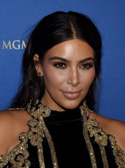 Kim Kardashian played down her pout with nude lipstick.