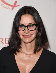 Courteney Cox kept it casual with this center-parted lob at the Women Cancer Research celebration.