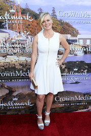 Alison Sweeney matched her frock with a pair of white platform sandals.