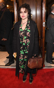 Helena Bonham Carter layered a black coat over her dress for some warmth.