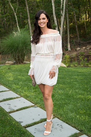 Katie Lee went boho-chic in a draped white off-the-shoulder dress for her Hamptons Magazine cover celebration.