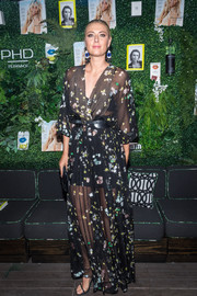 Maria Sharapova made an alluring statement with this sheer maxi wrap dress during her Hamptons Magazine cover celebration.