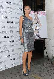 Heidi Klum dazzled at the 'Hamptons Magazine' issue party in sparkly silver Eros pumps.
