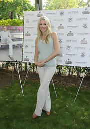 Aviva Drescher attended a Hamptons Magazine event wearing a casual tank and pants ensemble.