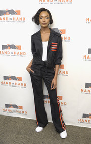 Jourdan Dunn looked cool and sporty in this pinstriped pantsuit at the Hand in Hand: A Benefit for Hurricane Relief.