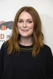 Julianne Moore wore her signature center-parted waves at the Hand in Hand: A Benefit for Hurricane Relief.