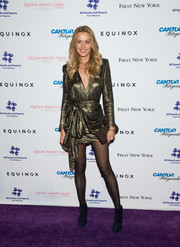 Petra Nemcova dazzled in a long-sleeve bronze cocktail dress with a bowed waist at the All Hands and Hearts event.