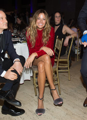 Kelly Bensimon paired gray fur sandals with a red dress for the All Hands and Hearts event.