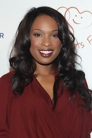 Jennifer Hudson showed off her deep maroon lipstick, which was a perfect match to her draped dress.