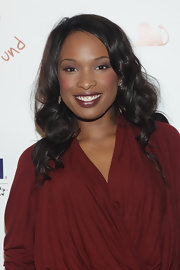 Jennifer Hudson was all smiles as she showed off her long curls while attending the Happy Heart's Fund's.