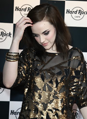 Amy Macdonald paired her metallic gold dress with a few gold and black bangles that worked perfectly with her outfit.