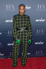 Ciara looked tough-chic in a grid-print jumpsuit by Off-White at the Harlem Fashion Row event.