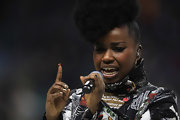 Misha B. wore a mirror-like metallic silver polish while performing in London.