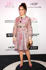 Salma Hayek looked ritzy in a Gucci shirtdress, featuring an ornate print and flower buttons, while attending the Harper's Bazaar 150 Most Fashionable Women celebration.