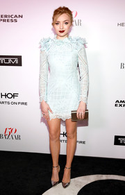Peyton List added more shine with a gold Jimmy Choo clutch.