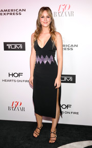 Sexy strappy heels by Jimmy Choo sealed off Leighton Meester's look.