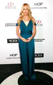 Rachel Zoe went for easy sophistication in a teal cold-shoulder jumpsuit from her own label when she attended the Harper's Bazaar 150 Most Fashionable Women celebration.