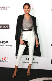 A black satin clutch tied Chanel Iman's look together.