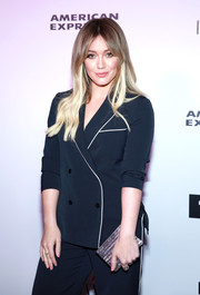 Hilary Duff teamed a metallic box clutch by Lee Savage with a navy pantsuit for the Harper's Bazaar 150 Most Fashionable Women celebration.