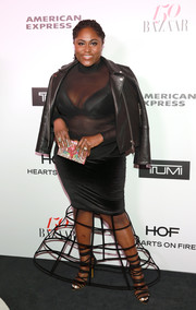 Danielle Brooks pulled her edgy outfit together with a black leather jacket.