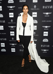 Padma Lakshmi attended the 2018 Harper's Bazaar Icons event rocking a fitted white jacket with a long train.