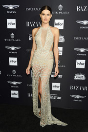 Isabeli Fontana paraded her supermodel body in a sheer nude gown by Berta at the 2018 Harper's Bazaar Icons event.