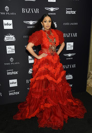 Cardi B made a grand entrance in a mega-ruffled red gown by Dolce & Gabbana at the 2018 Harper's Bazaar Icons event.