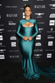 Dascha Polanco looked va-va-voom in a metallic teal cutout gown by Stello at the 2018 Harper's Bazaar Icons event.