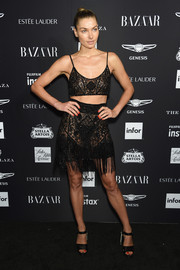 Jessica Hart completed her ensemble with black satin platforms.
