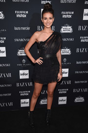 Victoria Justice looked flirty in a semi-sheer black one-shoulder dress by Aadnevik at the Harper's Bazaar Icons event.
