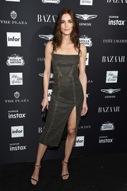 Hilary Rhoda cut a svelte silhouette in this high-slit, embroidered dress by Markarian at the 2018 Harper's Bazaar Icons event.