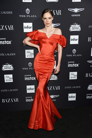 Coco Rocha went for classic glamour in a red off-the-shoulder mermaid gown by Zac Posen at the 2018 Harper's Bazaar Icons event.