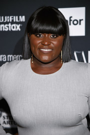 Danielle Brooks sported a short 'do with blunt bangs at the Harper's Bazaar Icons event.