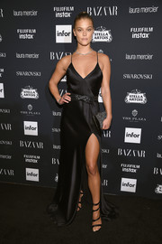 Nina Agdal amped up the sexy vibe with a pair of strappy satin sandals by Gianvito Rossi.