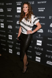 Brooke Shields paired a lace-accented one-shoulder top with a black leather skirt for the Harper's Bazaar Icons event.