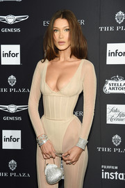 Bella Hadid glitzed up her nude outfit with a beaded silver purse by Judith Leiber for the 2018 Harper's Bazaar Icons event.